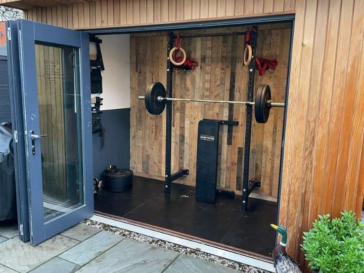 Garden Outbuilding Gym Featuring Folding Power Rack